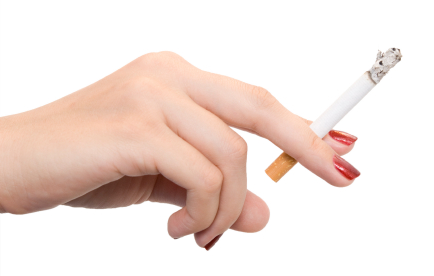 female hand with cigarette isolated on white