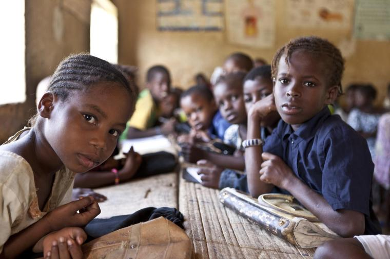 'Bahadou 2' school in Timbuctu. Hamssatou Touré (10), pictured in the front, and the other children are third-year students. The 'Bahadou 2' school is one of the 25 traditional schools located in the city of Timbuktu. With 1,080 students distributed in two cycles, the school holds large numbers of children in classrooms. After the departure of rebels who were driven out by the Malian and French armies, and in response to the humanitarian crisis, UNICEF provided schools with education and recreational kits for children and teaching kits teachers. Another partner, WFP has established a school canteen to keep children in school and address absenteeism from classes. The Timbuctu region is situated about 1050 km from the capital Bamako and is the 6th and largest region of Mali.